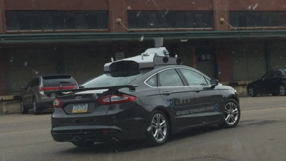 Uber's test vehicle driving in the Strip District on May 13, 2015.