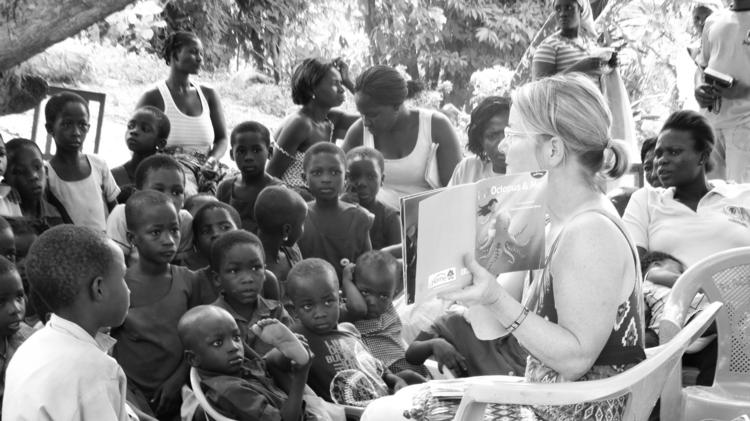 Mosaic CEO Shelly Morse reads to children in Ghana, where she takes employees with her on a volunteer trip. Now the company is shifting strategy to support employee causes.