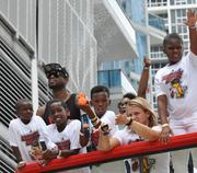 Dwyane Wade and his children. A lot of parade participants had squirt guns, which wasn't a bad idea in the sweltering Miami sun.