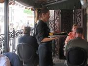 Cafe Gia waitress Elyse Costello serves customers on the restaurant's outdoor deck.