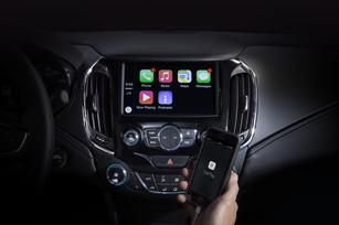Fierce competitors play nice at GM's joint Apple-Google integration launch