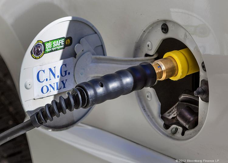 A compressed natural gas (CNG) pump fills the tank on an alternative fuel vehicle.