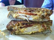 The Kickin' Pimento BTT sandwich features Southern jalapeno cheese spread, bacon, tomatoes, turkey on multigrain bread. The pimento cheese on Dash sandwiches is the same cheese served at the Masters Tournament.