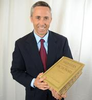 Michael Eugene, COO at Orange County Public Schools, with the dictionary that always had a prominent place in his home when he was growing up.