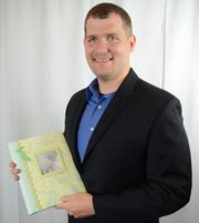 """Harry Ellis, chief information officer at Next Horizon, with his son's baby book, which contains personal items that """"simply could never be replaced."""""""