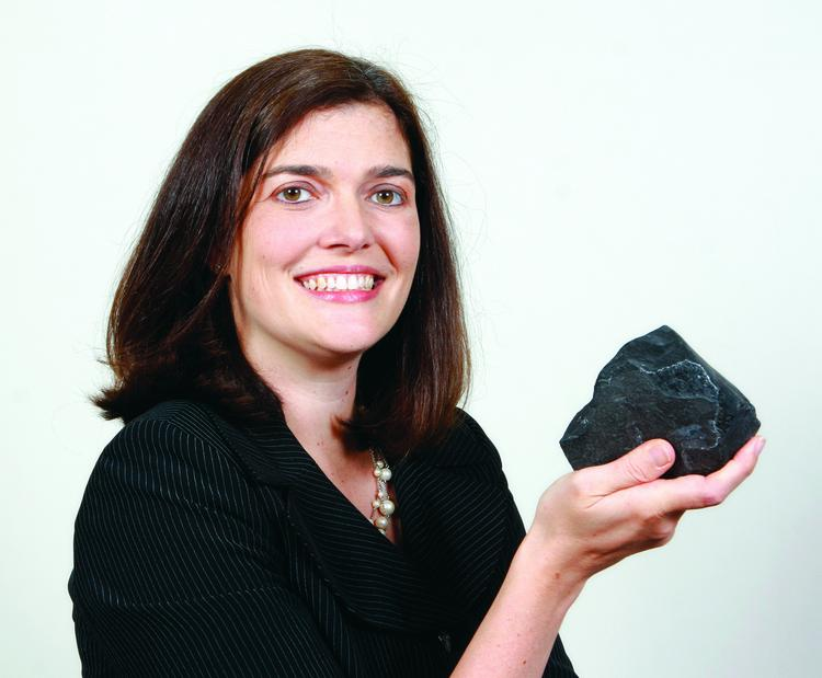 """""""I brought a piece of Marcellus shale with me to the photo shoot,"""" Nicolle Snyder Bagnell said. """"Even though I was working on oil and gas cases long before the development of the Marcellus Shale in this region, that development has been the key not only to significant growth and economic benefits to this region, but also to my professional success."""""""