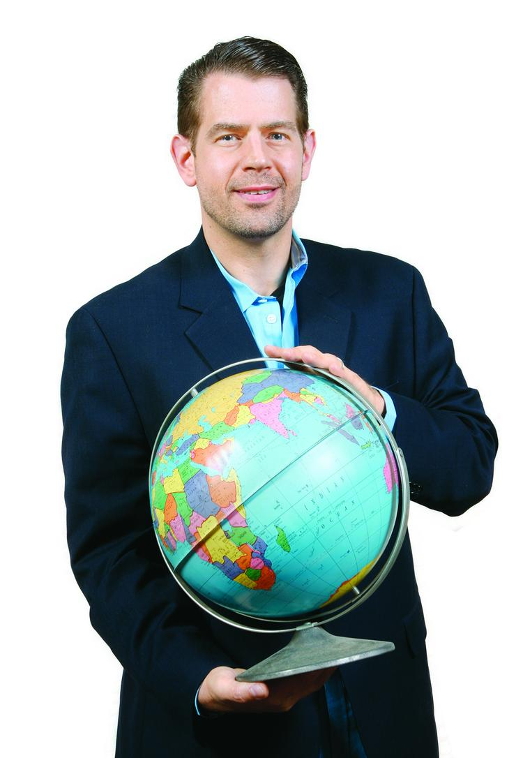 """Bryan Tamburro brought with him a globe because """"it just reminds me that we live in a small world."""""""