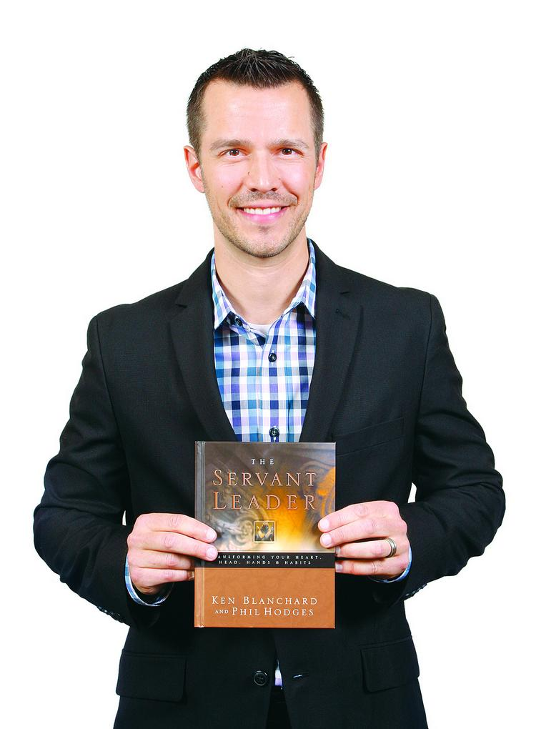 """""""I brought a book called 'The Servant Leader' by Ken Blanchard and Phil Hodges. This book really defines my leadership perspective and how I strive to be as a leader,"""" Dean Aloise said."""