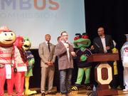 Spielman, with microphone, and his fellow OSU alums were joined on stage at one point by OSU mascot Brutus Buckeye, Columbus Clippers mascot Krash, Columbus Blue Jackets mascot Stinger and a couple Buckeyes super-fans loved by television cameras.
