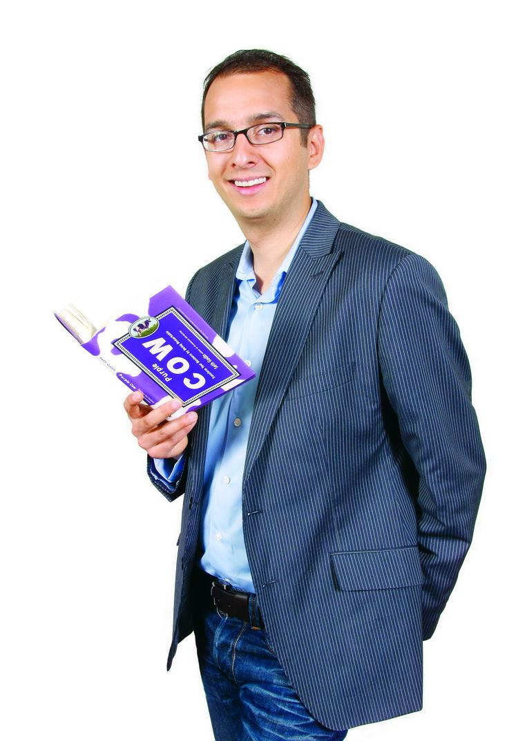 """Sean Ammirati brought """"Purple Cow: Transform Your Business by Being Remarkable,"""" by Seth Godin. It was published in 2003 as he was joining Peak Strategies and he gave a copy to the other two co-founders. The message from Godin's book helped to formalize his thinking as he was leaving Carnegie Mellon University."""