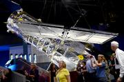 A full-size replica of the Hubble Telescope is suspended near the orbiter. Atlantis was the shuttle flown for the Hubble repair mission in 2009.
