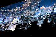 A 40-foot-long projection screen plays animated space scenes including a sunrise and a fly-by by the International Space Station.