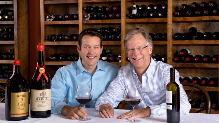 Ryan Fletter, the 12-year general manager and new owner of Barolo Grill, toasts to the acquisition with founder and now-former owner Blair Taylor.