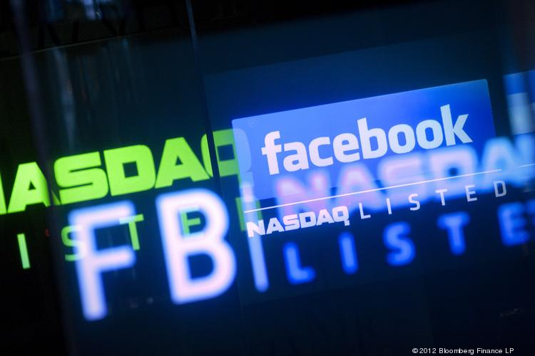 The Facebook Inc. logo is displayed at the Nasdaq MarketSite in New York, U.S., on Friday, May 18, 2012.