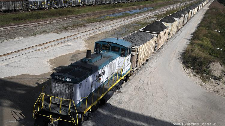 Phosphate rock loaded into railroad cars is ready to be transported to the Mosaic Co. fertilizer chemical plant in Tampa, Florida, U.S., on Friday, Dec. 2, 2011. Mosaic Co. is the world's largest producer of phosphate and second-largest producer of potash, two crop nutrients which are primary ingredients in producing fertilizer. Photographer: Jim Stem/Bloomberg