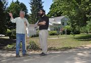 Lance Manning, River Street resident and owner of River Street Photography, talks with Mayor Matthew Avitabile about storm debris left on his property after flash flooding on June 12 ripped through the community.