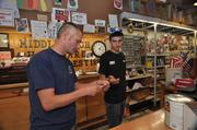 Rich Vilegi (left), co-owner of Middleburgh Hardware on 316 Main Street, with employee Travis Foland. Vilegi's store suffered severe damage from Irene.