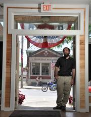 Middleburgh Mayor Matthew Avitabile in the doorway of Four Star Realty Group on Main Street. Village hall is in the background.