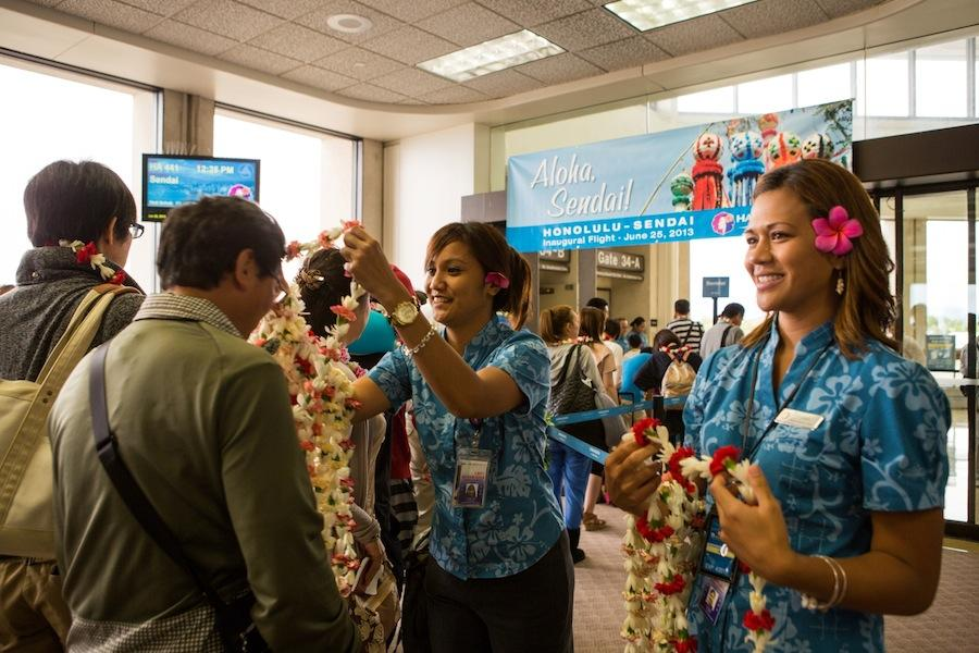 Hawaiian airlines launches flights from honolulu to sendai japan from left hawaiian airlines customer service agents starlynn kuaana and charael perry greet passengers with m4hsunfo
