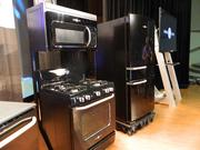 The Artistry appliance line includes a dishwahser, range, over-the-stove microwave oven and refrigerator.