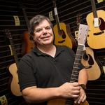 Guitar shop owner to sell building