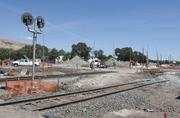 A crew works on grade separation at the Warren Avenue intersection. The two freight tracks will eventually pass over the street on two track bridges.
