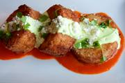 The Buffalo Style Grit Cakes boast avocado ranch, blue cheese crumbles, buffalo jus and micro celery for $10.