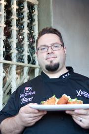 Chef Jeff Taylor, who goes simply by Chef Jeff, shows off the Buffalo Style Grit Cakes.