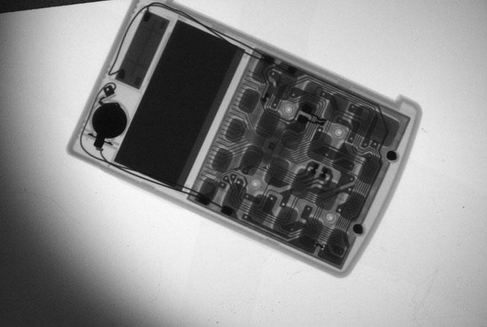 Pictured is a hand-held calculator that was X-rayed by Los Alamos National Laboratory researchers using the MiniMAX camera, a lightweight, portable X-ray machine.