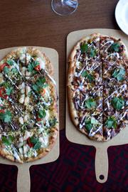 The garlic shrimp and barbeque beef flatbreads. The first is topped with shrimp, chorizo, mozzarella, cilantro pesto and pickled chili for $15. The second has smoked gouda, red onions, cilantro, B&B jalapenos and crema for $14.