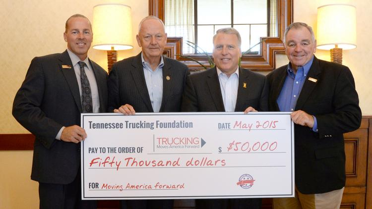 (Left to right) Scott George, CEO of Tennessee Commercial Warehouse, Tommy Hodges, Titan Transfer chairman and TTF, Dave Manning, TCW president and American Trucking Associations vice chairman and Bill Reed of Skyline Transportation present the $50,000 contribution to Trucking Moves America Forward.