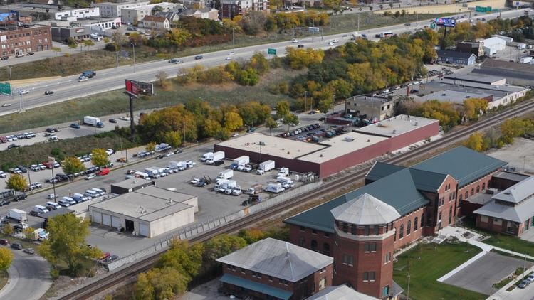 J.M. Brennan will expand its St. Paul Avenue building to the west onto a former trucking facility it purchased in May.