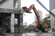 Demolition is underway on part of the former Honolulu Advertiser building, which will be developed into a $200 million high-rise affordable condominium tower.