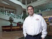 Lance Tucker, CFO of Papa John's International Inc., is shown in the entrance to the company's headquarters.