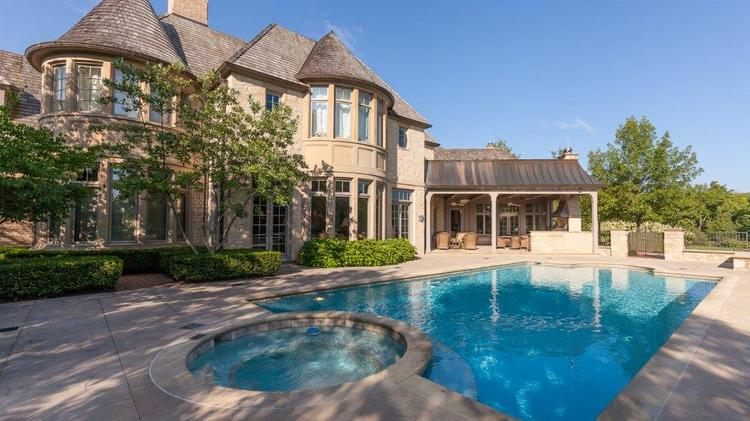 The Muirfield Village home has a salt water pool and outdoor kitchen.