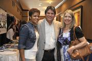 From left: Janelle Rayford, Elevation Construction Group;  Sergio Rocha, Wilkinson & Asociates; and Nancy Braun, Showcase Realty.