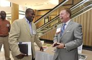 From left: Leon Hicks of I Clean Janitorial and Matt Kern of HF Financial.