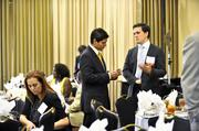 Standing, from left: Julian Arcila of the Hispanic Contractors Association of the Carolinas and Aaron Biller of HF Financial