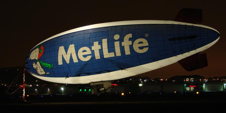 MetLife's numbers gained altitude and the insurer got back in the black in its latest quarter.