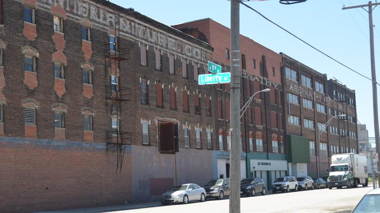 Developer closes on six pack of west bottoms buildings for Furniture kansas city