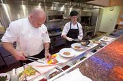 Executive chef Graham Weber and cook Leslie Irvin put together dishes for a group at Blu.