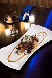 A pancetta-wrapped filet with potato gnocchi and parmesan creamed spinach at Blu.