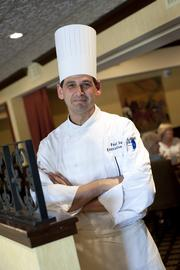 Chef Paul Sant in the Blue Horse dining room.