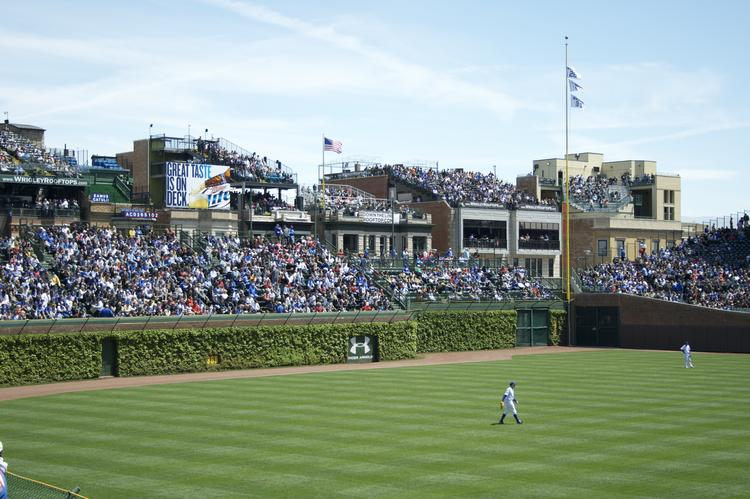 Wrigley Field rooftop clubs can look over the ballpark's walls and onto the field of play. That could change if the Cubs are allowed to erect advertisements behind the bleachers.