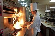 Chef Paul Sant in the Blue Horse kitchen, creating one of his signature dishes.
