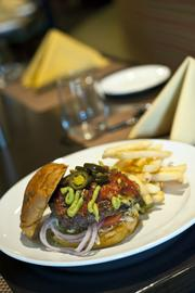 One of the features at Blue Horse is an extensive International hamburger menu.  Pictured here is a Mexican Burger with avacado, jalepeno peppers and salsa.