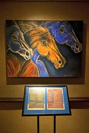 Blue horse paintings decorate Blue Horse restaurant at the Crowne Plaza Hotel.