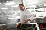 Chef Ryan Montgomery grilled a dry-aged ribeye steak in the kitchen at Charr'd.