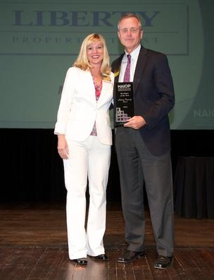 NAIOP President Traci Jenks, a senior associate with CBRE Group Inc., and Mike Heise, vice president and city manager for the Jacksonville area for Liberty Property Trust, who took home three awards for the 45,000-square-foot office facility Liberty developed for Concorde Career Institute: Office project of the year, sustainable project of the year and developer of the year.