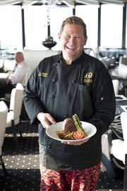 Chef Brian Riddle with one of his signature dishes at Rivue.